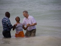 Dr. Larry Saunders baptizes a convert from the church in Little London Jamaica