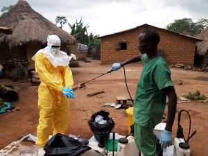 An Ebola response worker is decontaminated in West Africa after helping to remove bodies. ©EC/ECHO/Jean-Louis Mosser