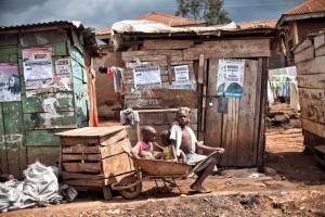 Three children in a wheelbarrow, Kampala, Uganda, © 2011 - Brian Wolfe, Flickr.