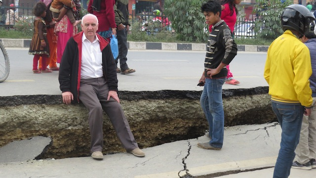 Rev. Wesley Graham sits on a piece of damaged road in Kathmandu, Nepal.