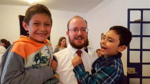 Rev. Boyle with some of the children in the church.