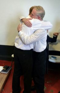 Rev. Jason Boyle hugs his father immediately after his ordination to the gospel ministry.