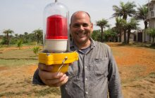 Missionary David DiCanio holds the Aircraft Warning Light that will sit atop the 150 foot radio station tower on the mission property in Duazon.