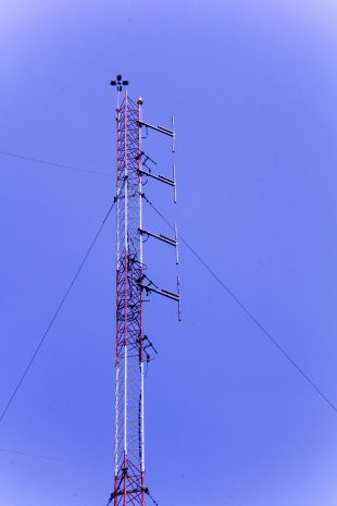 A four-bay antenna sits atop the 150 foot radio station tower.
