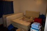 One of the guest bedrooms currently used for storage.jpg