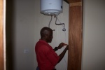 John Scott, of Scott and Scott electrical, connects the hot water heater.jpg